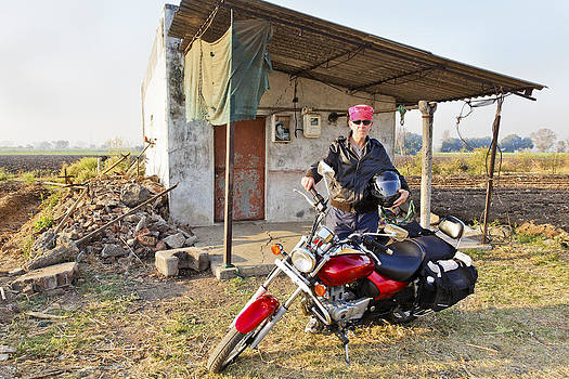 Kantilal Patel - Caucasian Biker outside country shack