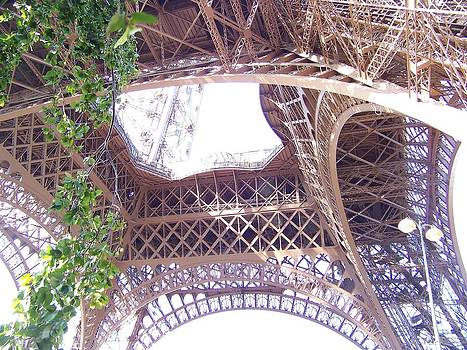 center of the Eiffel Tower by Maggie Cruser