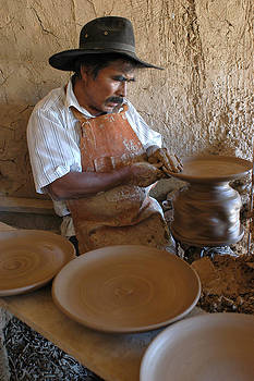 Ceramist working in his workshop. Department of Cochabamba. Republic of Bolivia. by Eric Bauer