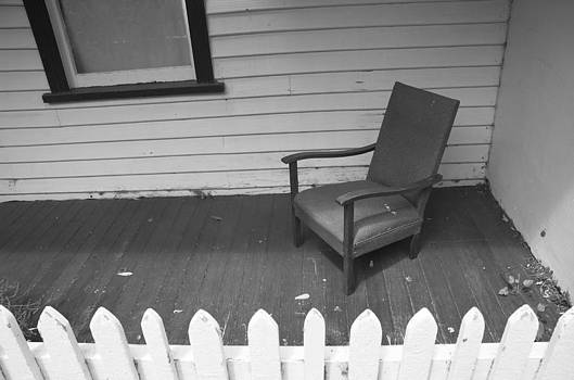 Chair on veranda. by Alex Hinds