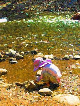 Child gathers rocks by Annie Gibbons