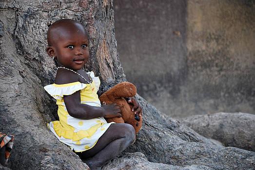 Child With Her Teddy by Kamel Rekouane