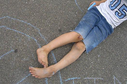 Childhood - Boy draws with chalk by Matthias Hauser