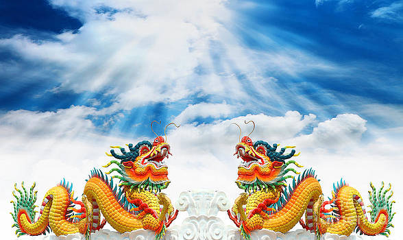 Chinese dragons statue with cloud and sky by Phalakon Jaisangat