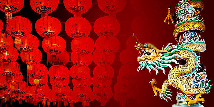 Chinese style dragon statue with Chinese Red lanterns at night   by Chaloemphan Prasomphet
