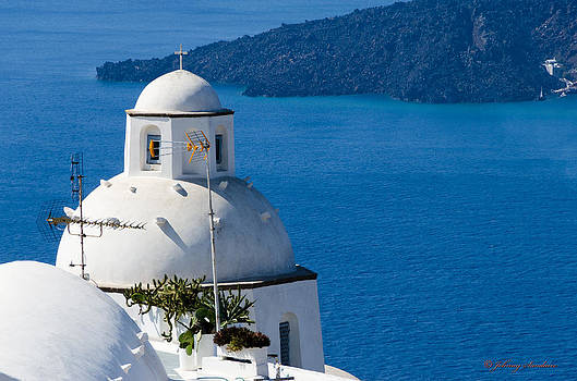 Church over greece ocean by Johnny Sandaire