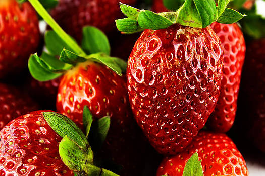 Close Up of fresh strawberry berries  by Chaloemphan Prasomphet