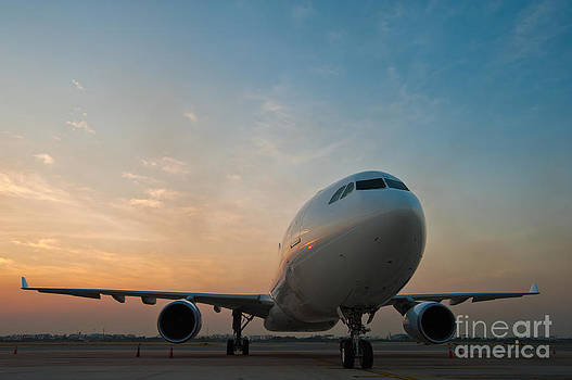 Commercial airplane parking at the airport by Sattapapan Tratong