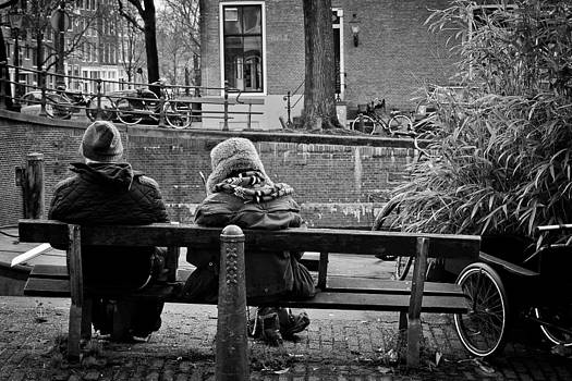 Couple On Bench in Amsterdam by Les Abeyta