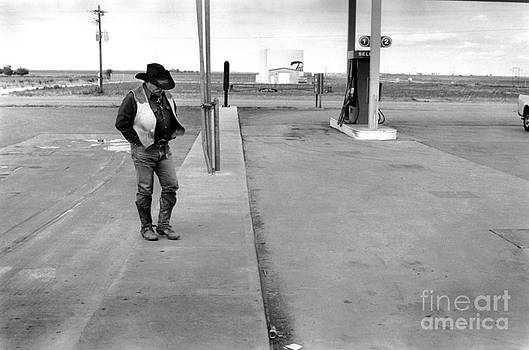 COWBOY and GAS STATION  by Homer Sykes