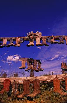 Cowboy Boots On Fence Great Sand Hills Saskatchewan Canada by Design Pics