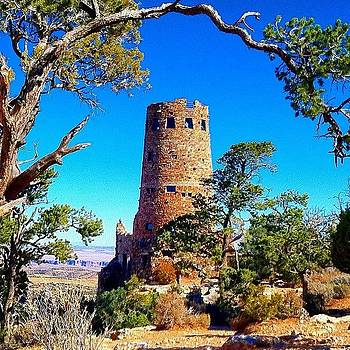 Desert View Tower At The Edge Of The by Michael Misciagno