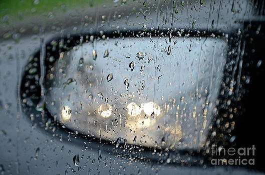 Sami Sarkis - Drops on car window and side-view mirror