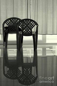 Empty chairs by Vishakha Bhagat