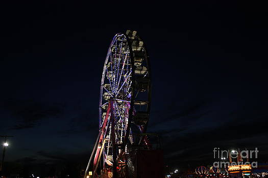 Fairis Wheel Light's at Night by Robert D  Brozek