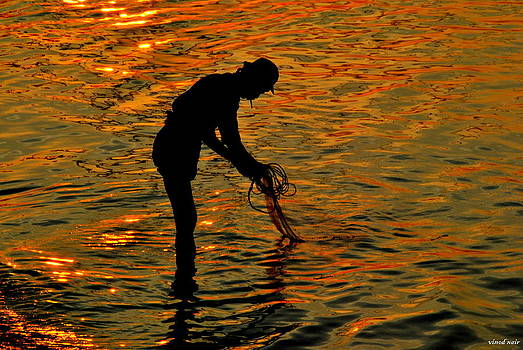 Fisher man at Dusk by Vinod Nair
