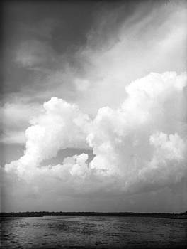 Florida Clouds over water by T R Maines