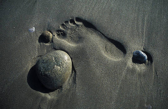 Foot trace on a beach by Michal Cerny