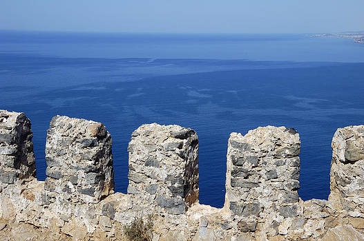 Fortification wall and blue ocean by Matthias Hauser
