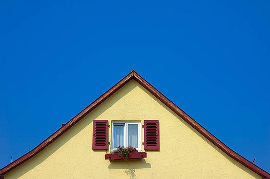 Gable of beautiful house in front of blue sky by Matthias Hauser