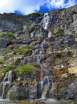 Going to the Sun Road Waterfall by Roland Schulz