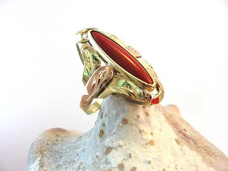 Golden Ring And Eye Of Red Coral by Leo Wildner