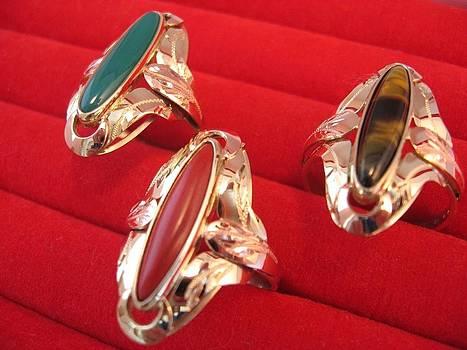 Golden Rings And Eye Of Gemstone by Leo Wildner