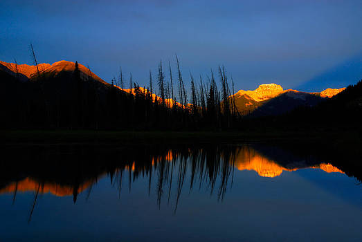 Golden Sunrise with blue background on Vermillion Lake by Hegde Photos