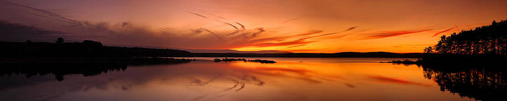 Golden sunset panorama on a quiet lake by Sebastien Coursol