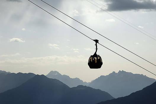 Gondola lift and mountains by Matthias Hauser