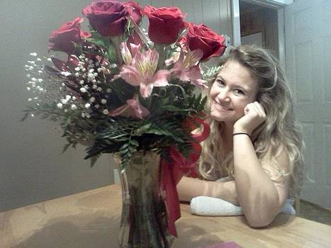 Granddaughter with beautiful roses by Sandra Michel