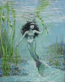 Green mermaid harvesting by Maria Elena Gonzalez