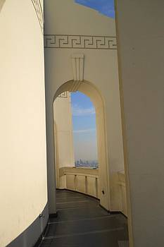 Griffith Park Observatory 1930s style arches at curved walkway with city skyline in background by Eve Paludan