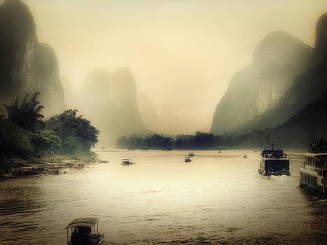 Guilin River Men by Stuart Deacon