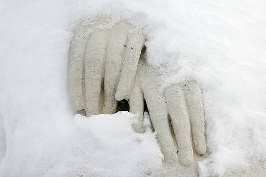 Hands of a statue covered with snow by Matthias Hauser