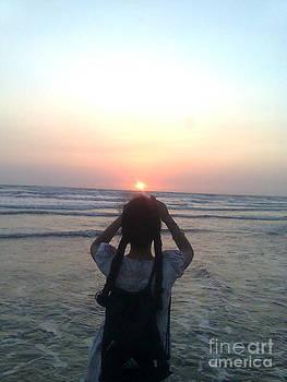 Holding the sun by Bgi Gadgil