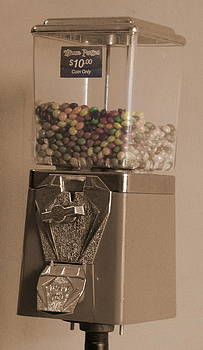 Jamaican ten dollar coin candy machine by K Walker