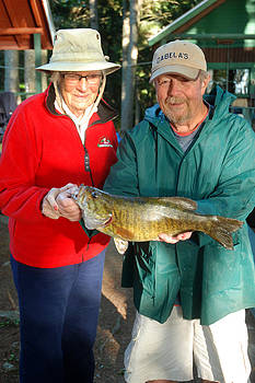 Robert Anschutz - Jean and Robert w/fish