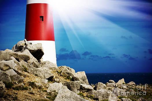 Simon Bratt Photography LRPS - Lighthouse on rocks with light beams