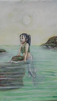 Little mermaid Reyna exploring and playing by Maria Elena Gonzalez