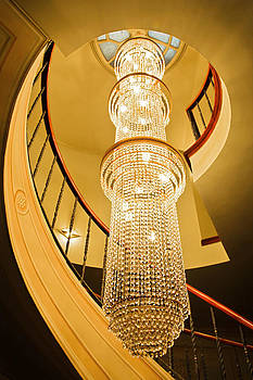 Kantilal Patel - Long chandelier lights up the wall