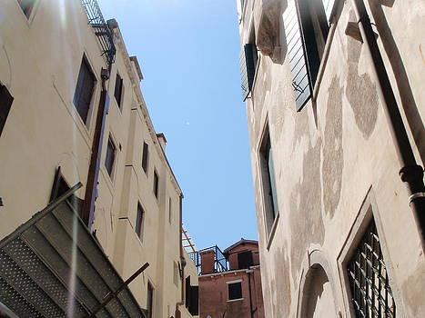 Looking up from a gondola Venice Italy by Gina Clayton-Tarvin