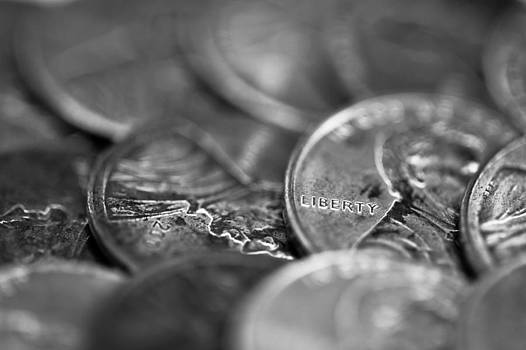 Macro image of coins in black and white by Anya Brewley schultheiss