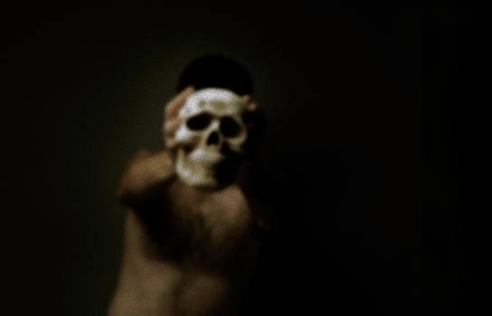 Man Holding Skull by Mark Wagoner