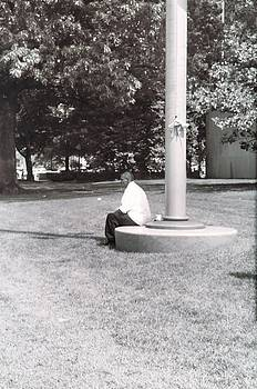 Man Resting at Pole by Floyd Smith