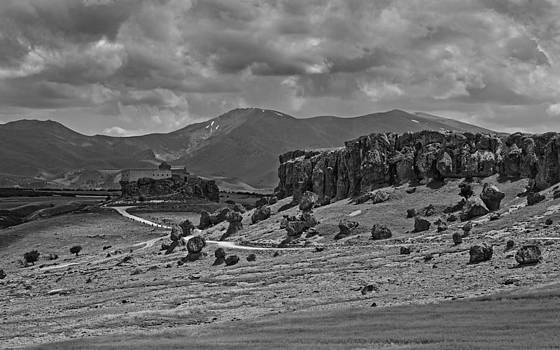 Kantilal Patel - Moody landscape over volcanic terrain