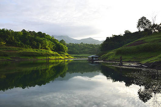 Mountain and lake by Kanoksak Detboon