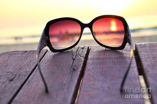 Ocean sunset through the sunglasses by Alexander Chaikin