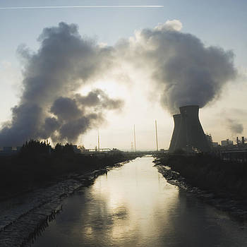 Oil Refinery Buildings Silhouetted by Iain  Sarjeant