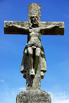 Old cross and Christ in blue sky by Inacio Pires